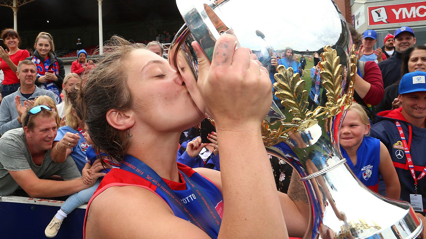 Ellie Blackburn of the Bulldogs celebrates with the trophy