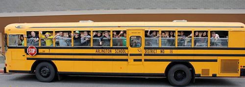 The students gave the grandmother a poster of them all waving from the bus. (Facebook)