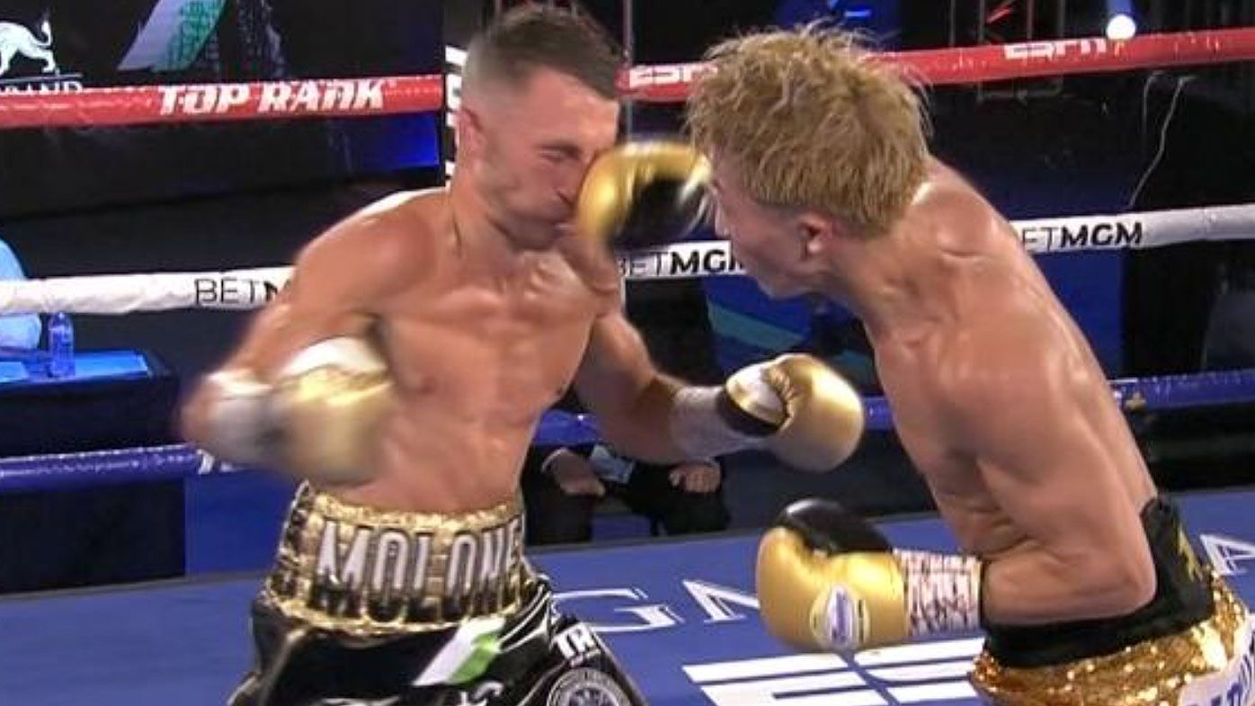 Jason Moloney goes down to  Naoya Inoue