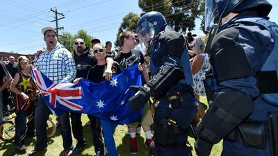 Melton locals are separated by police from the Campaign Against Racism and Fascism protesters. (AAP)