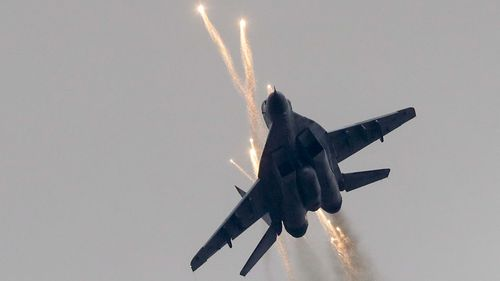 A Russian jet opens fire during last year's war games.