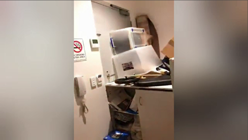 A video posted by the siege suspect showing the barricaded door.