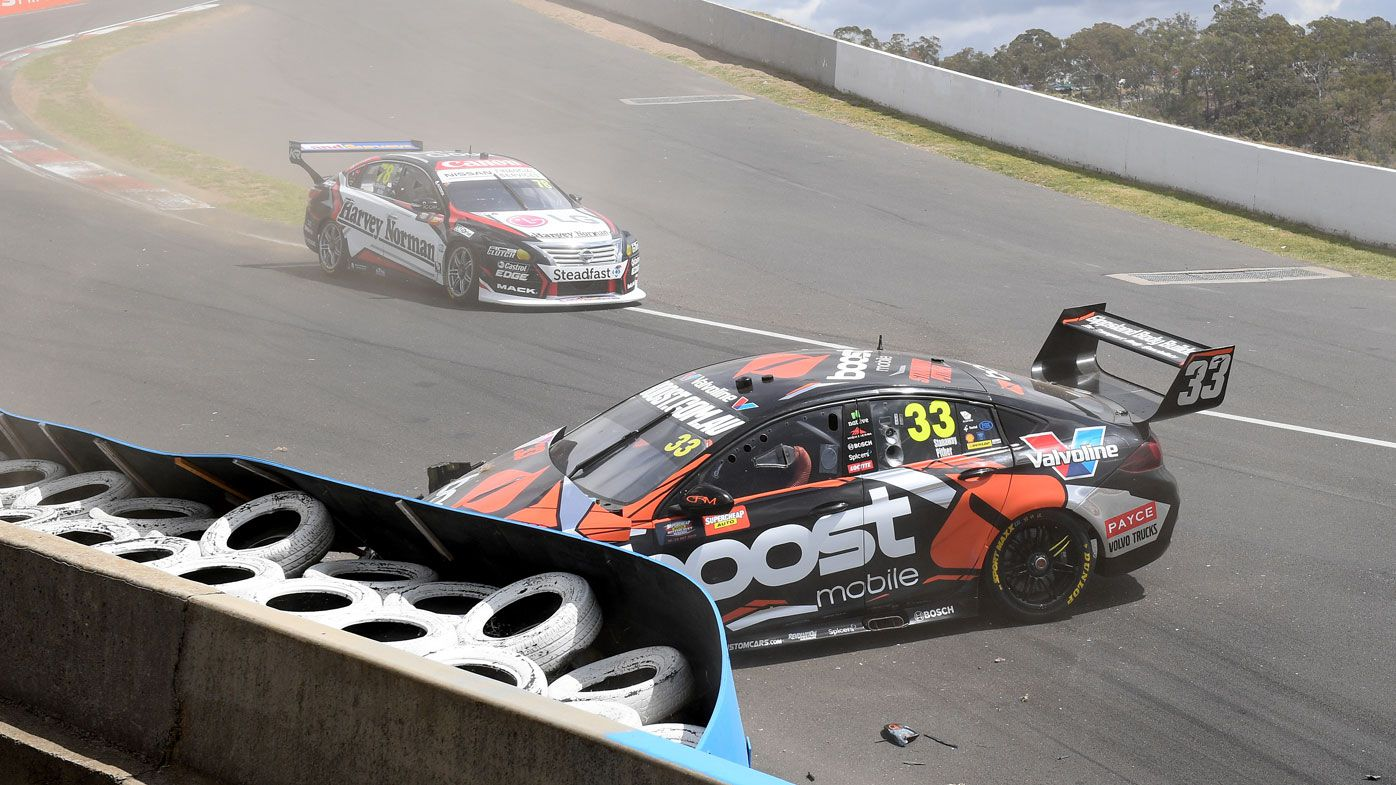 Richie Stananway in the Boost Mobile Racing Holden inspects damage after crashing during practice