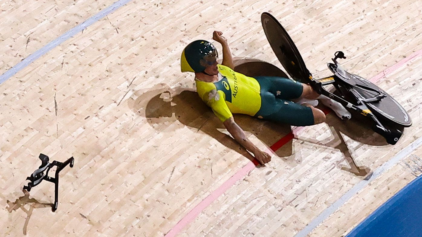Alexander Porter falls during the men's team pursuit qualifying cycling track event.