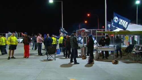 Sacked workers protested through the night. (9NEWS)
