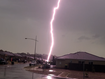 Moment lightning strikes parked car