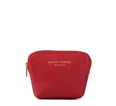 """<p><a href=""""https://deadlyponies.com/shop/poucher/red/"""" target=""""_blank"""">Deadly Ponies Mini Poucher in Red, $89.95.</a></p> <p>All white is all right when you add a pop of colour with a stylish accessory such as this bright and bold pouch.</p>"""
