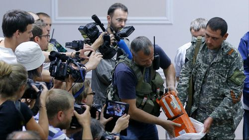 Pro-Russian rebels unveil the MH17 black box. (AAP)
