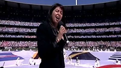 "We can't help but feel Irene Cara's performance of ""Flashdance (What a Feeling)"" at the 2006 Grand Final may not have been the best fit for a stadium filled with footy fans. (YouTube)"