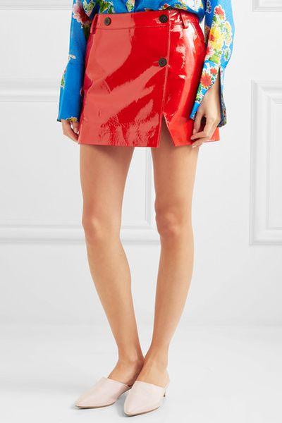 """Patent leather wrap skirt, Topshop Unique at <a href=""""https://www.net-a-porter.com/au/en/product/910630/Topshop_Unique/patent-leather-wrap-mini-skirt"""" target=""""_blank"""" draggable=""""false"""">Net-a-porter</a>, approx. $287.47<br>"""