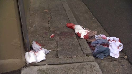 Bloodied clothes are seen strewn in Potts Point after a brutal attack with a 'box cutter like instrument.'