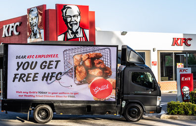 Grill'd billboard outside KFC store