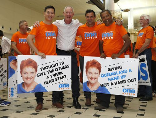 One Nation's Guansheng Zhang, Steve Dickson, Jason Quick and Paul Taylor wait for the arrival of Pauline Hanson. (AAP)
