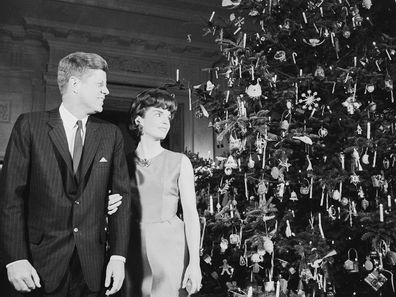 John F. and Jackie Kennedy with their 1962 White House Christmas tree.