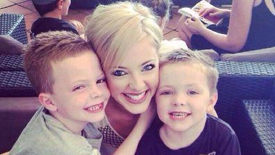 Kate Austin hugging her boys
