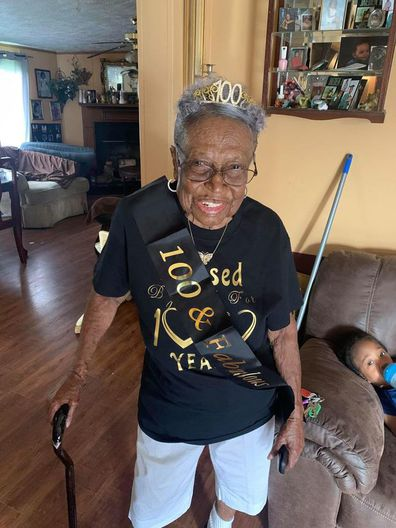 Woman marks 100th birthday with drive-thru party