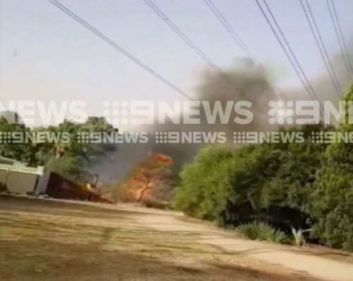The fire spread to properties. (9NEWS)