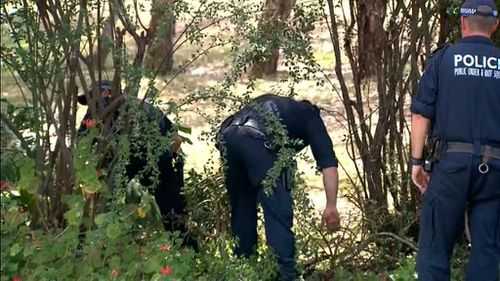 Police are searching nearby scrub as they investigate the discovery. (9NEWS)