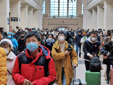 People wear face masks as they wait at Hankou Railway Station on January 22, 2020 in Wuhan, China.