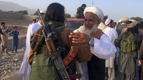 Taliban fighters gather with residents to celebrate a three-day cease fire marking the Islamic holiday of Eid al-Fitr, in Nangarhar province, east of Kabul, Afghanistan. Picture: AP