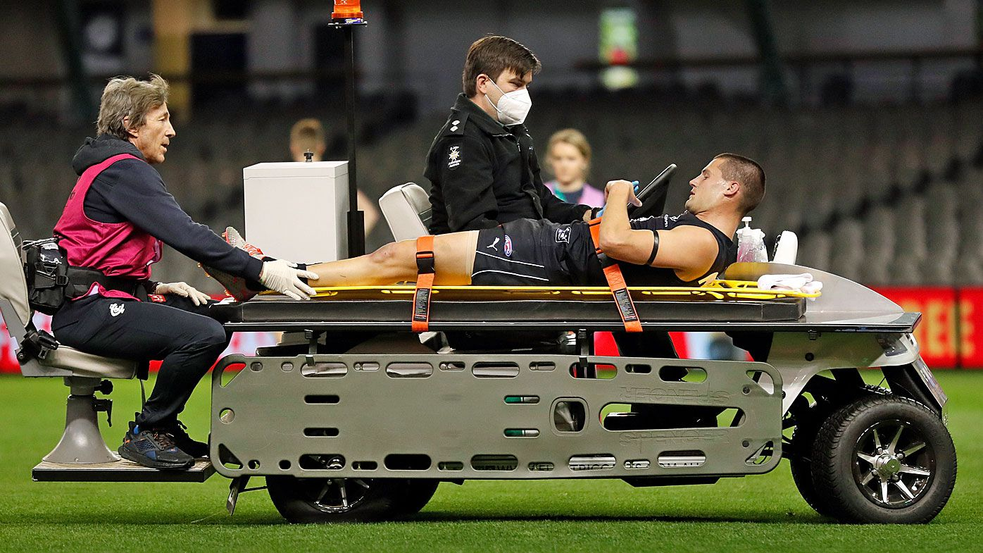 Carlton Blues star stretchered off as Melbourne Demons win nail-biter
