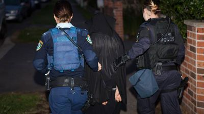 "A total of 14 men are arrested in the raids, with one man charged with serious terrorism offences. Police reveal that some people resisted arrest and officers used ""reasonable force"" to take them into custody."