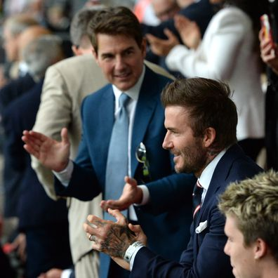 Former England international David Beckham and actor Tom Cruise applaud prior to during the UEFA Euro 2020 Championship Final between Italy and England at Wembley Stadium on July 11, 2021 in London, England.