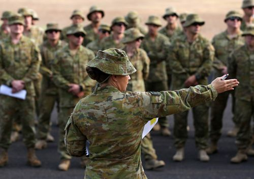 Australian Army Reserve and Regular personnel are seen during a roll call ahead of departing the Holsworthy Barracks to support bushfire efforts across NSW