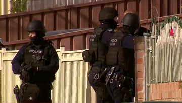 A siege is underway in south-west Sydney with an armed man holed up in a house in Carramar.