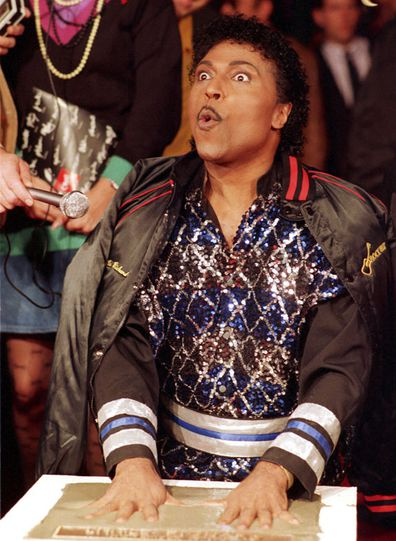 In this Nov. 13, 1986 file photo, Little Richard places his hands in cement as he is inducted into Rock Walk, a sidewalk collection of handprints and signatures of rock and roll musicians, in Los Angeles.