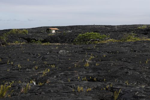 A structure is seen atop the 1990 lava flow. (AP)