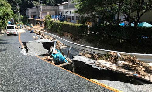 The flooding has torn up transport links such as this road. (Photo: AP).