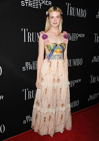 Elle Fanning accentuates her ethereal, gauzy gown with a childlike crystal hairclip.