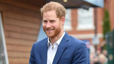 Prince Harry joins schoolchildren as they take part in a tree planting project.