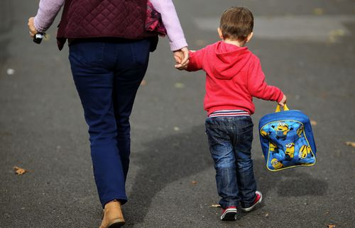 Many south-east Queensland parents have been told to pick their children up early. (AAP)