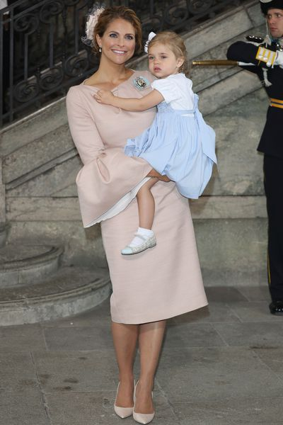 Princess Madeleine of Sweden, wearing Giambattista Valli, and Princess Leonore of Sweden at the christening of Prince Oscar of Sweden in Stockholm, May, 2016