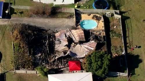 The remains of a Queensland property destroyed by fire.