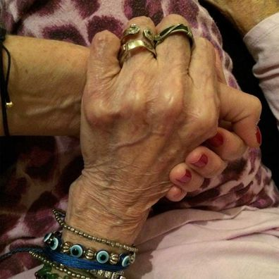 Rita Wilson shares heartbreaking image of her holding her mother's hand before she stopped speaking from Alzheimers.