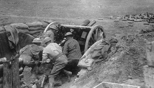 Australian artillery gunners in action at Bullecourt. (Photo: Australian War Memorial).