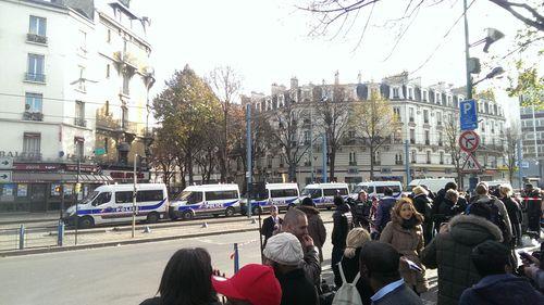 Police vans line the street following the deadly raids in Saint-Denis. (Jack Hawke, 9news.com.au)