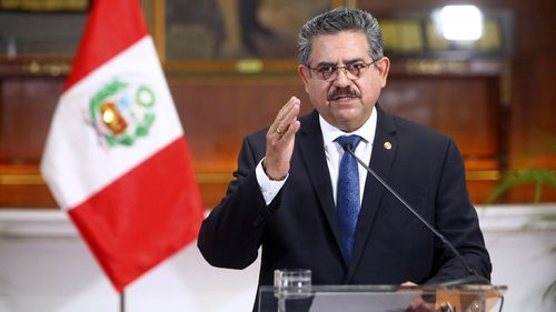 Peru's interim president Manuel Merino announces his resignation via a televised address from the Presidential Palace in Lima, Peru.