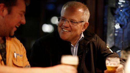 Prime Minister Scott Morrison meets locals at Molly Malone's Irish Pub in Devonport, Tasmania on Wednesday.