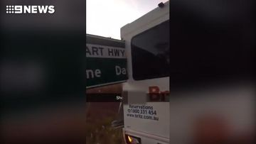 Tourists drive van through sign on Northern Territory highway
