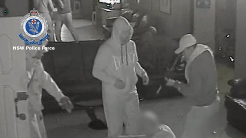 Police are hunting three men who robbed two Sydney brothels earlier this year while armed with a paintball gun. Picture: Supplied.