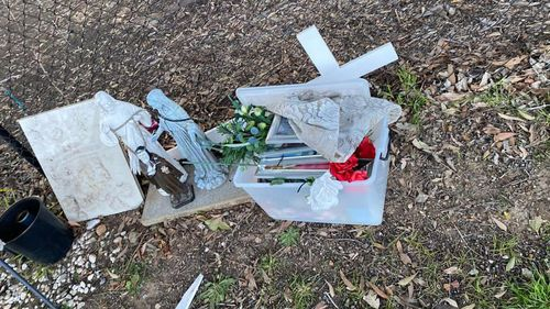 Parts of the temporary roadside memorial removed on Bettington Road, Oatlands.