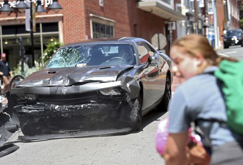 A vehicle reverses after driving into a group of protesters demonstrating against a white nationalist rally in Charlottesville, Virginia on August 12, 2017. The 2017 attack killed 32-year-old Heather Heyer and injured dozens of others. The car attack came after the rally had descended into chaos, with brawling breaking between white nationalists and counter-demonstrators.