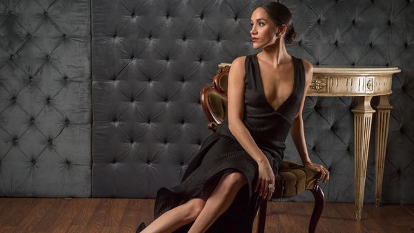 Meghan Markle looks incredible in this black gown with plunging neckline. Image: Getty.
