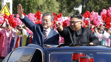Moon Jae-in and Kim Jong-un during a welcome parade in Pyongyang, North Korea.