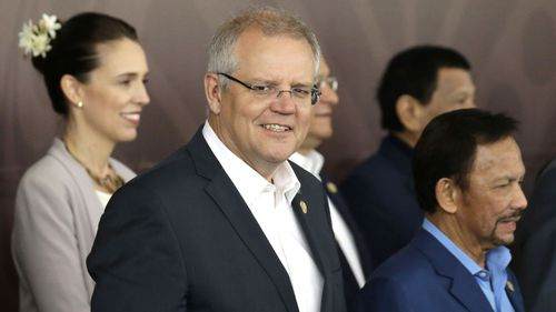 Australia's Prime Minister Scott Morrison, center, poses for a group photo at APEC Haus in Port Moresby, Papua New Guinea.