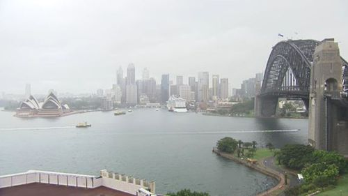 Heavy rainfall hammers Sydney marking end of hottest summer on record